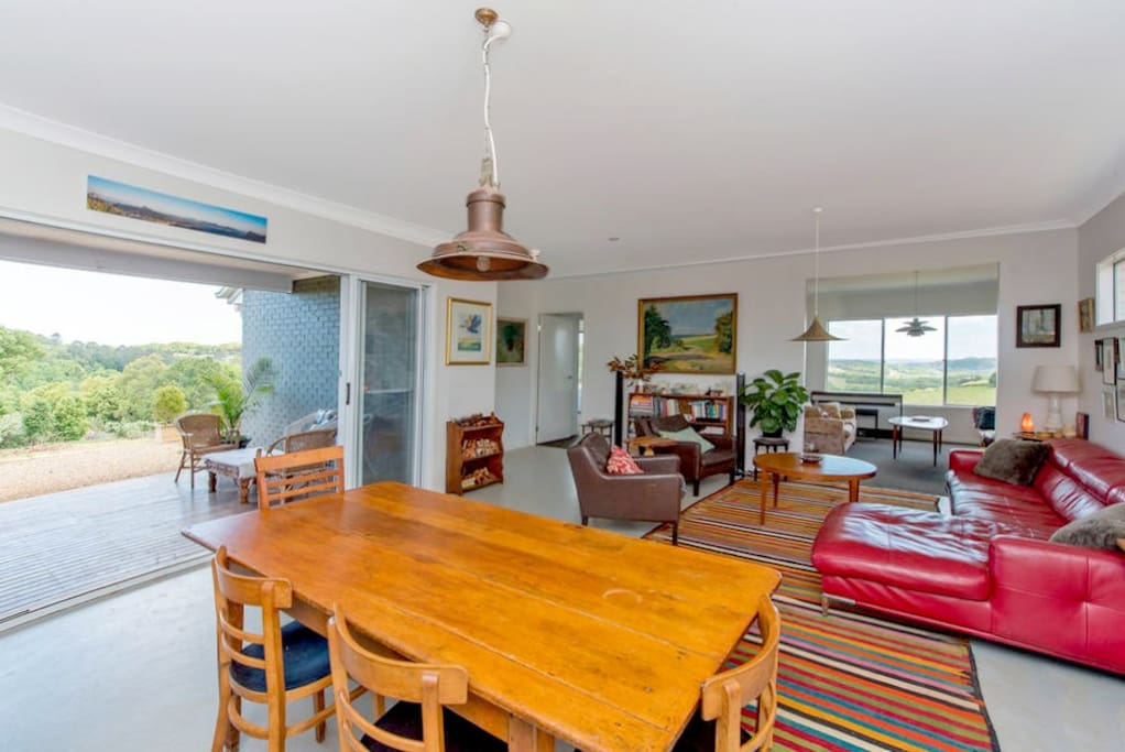 Open plan living space leads on the covered deck