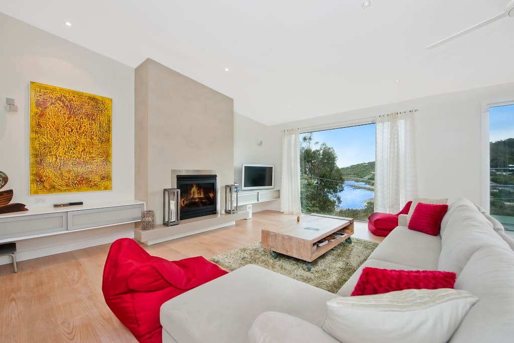 The comfortable upstairs lounge with tv and gas log fire which leads out onto the deck