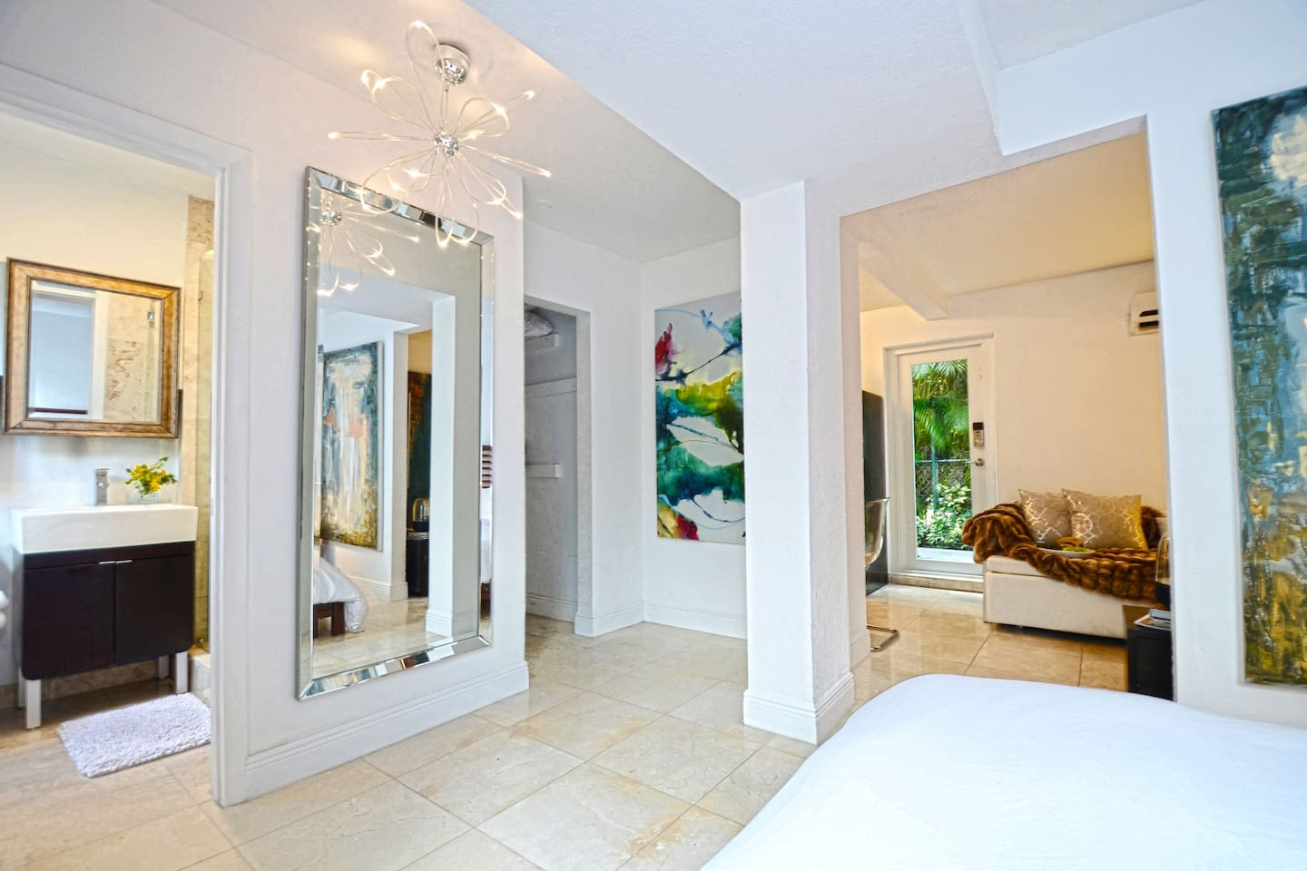 View from the bedroom area. The entry door is an impact resistant hurricane-proof door with a roll down shade for privacy