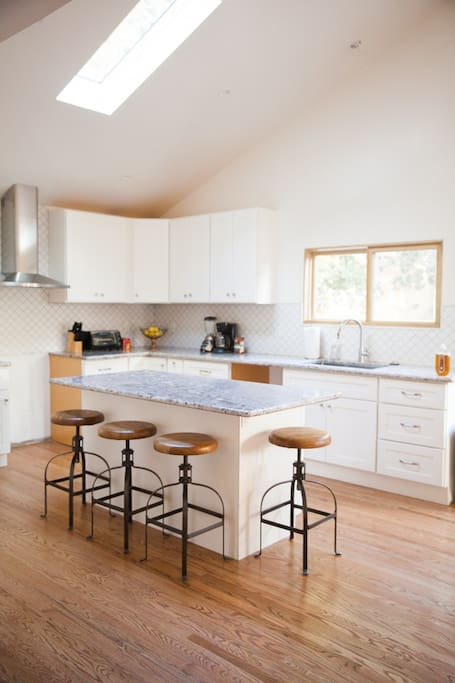 Brand new kitchen with an eat-in kitchen island.