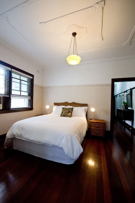 Master bedroom with Queen bed, built in robe and air con.