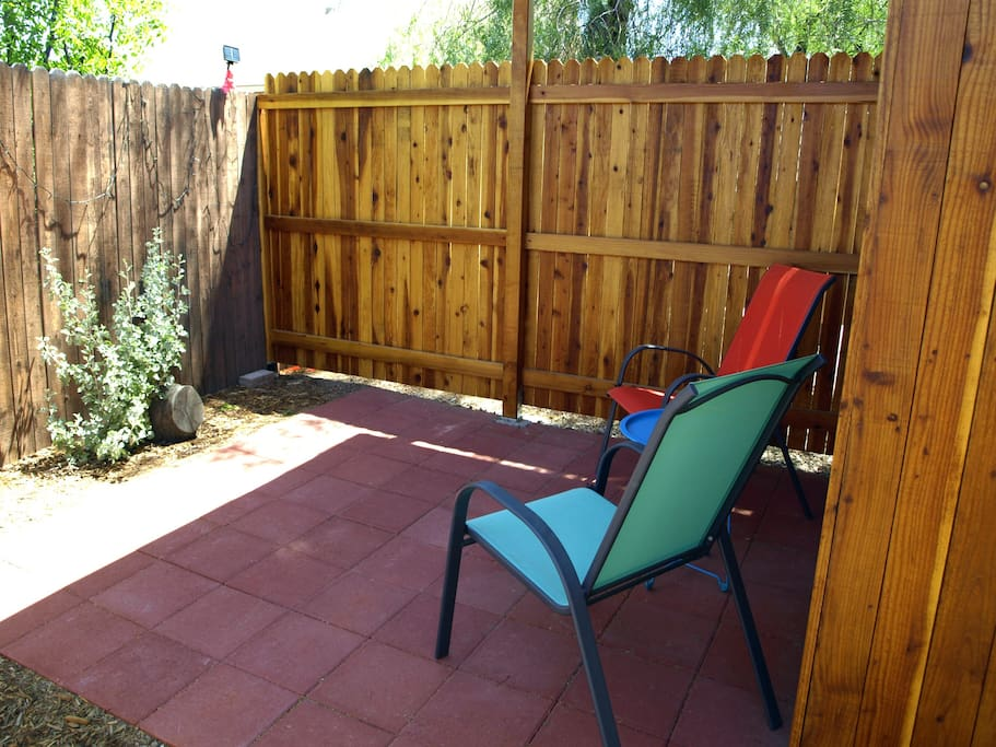 Partially covered patio provides mix of shade and sun.