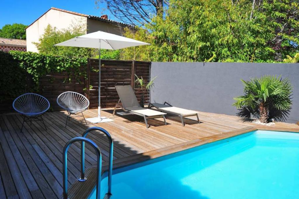 Private, heated pool with sun launchers