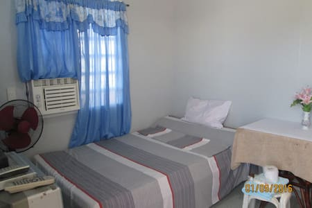 A Modest Air-conditioned Room - Davao City - Hus