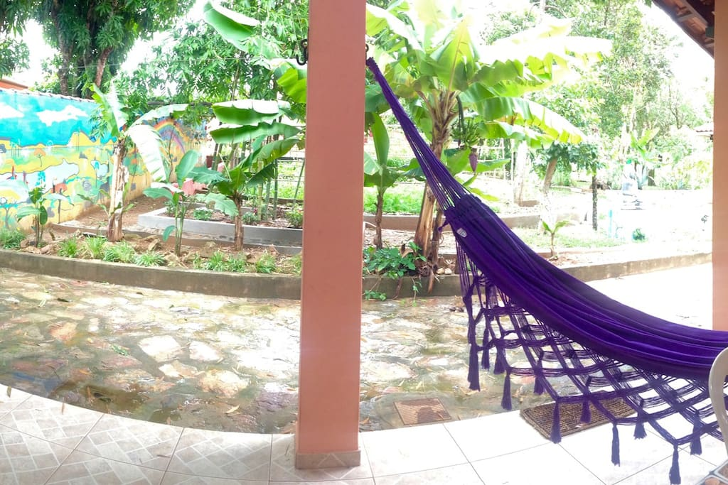 The veranda with hammocks to relax and enjoy the view on the garden