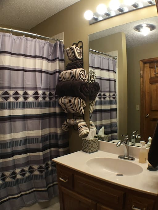 The decorated master bathroom includes a walk-in shower.