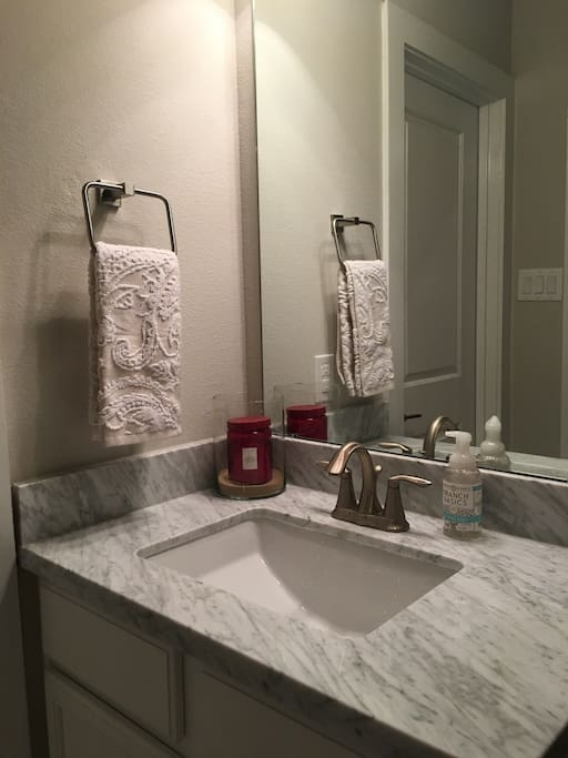 Private bathroom with walk in shower, toilet and sink