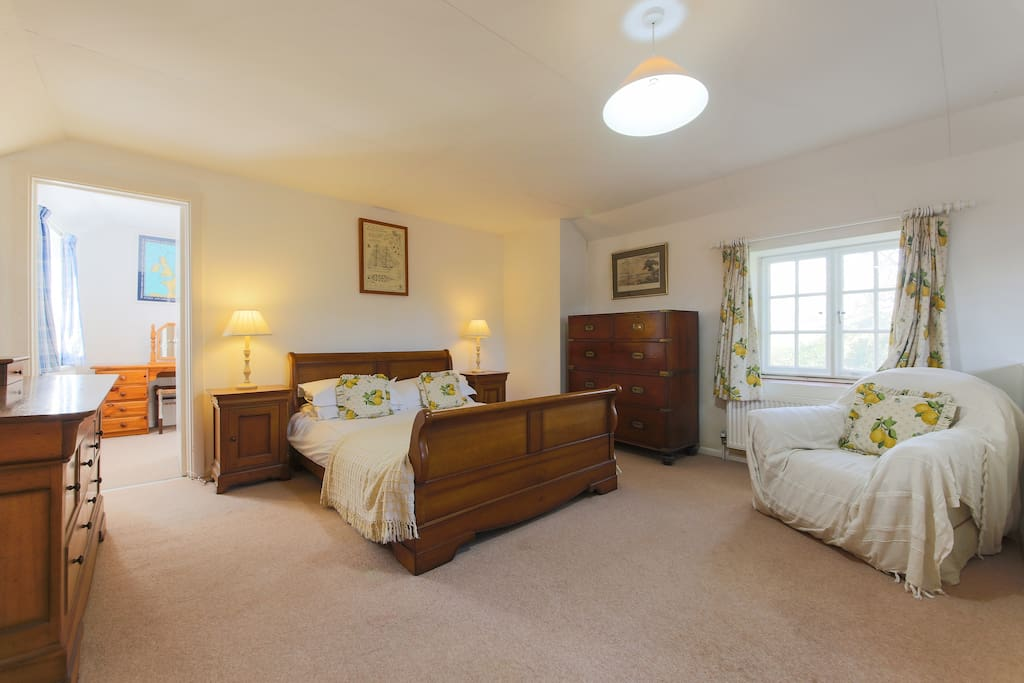 Bright master bedroom with twin room off it at Liitle Albion holiday cottage Bells Hill Mylor