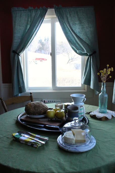 Breakfast offering: guests will find a freshly baked loaf of bread, fruits, and a sampling of our farmstead cheeses awaiting them upon arrival.