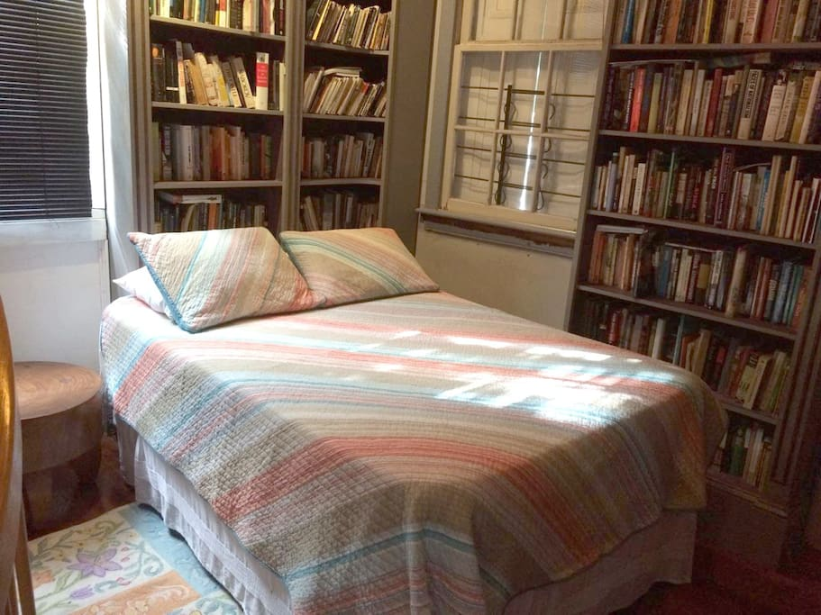 The new queen-sized bed in the library.