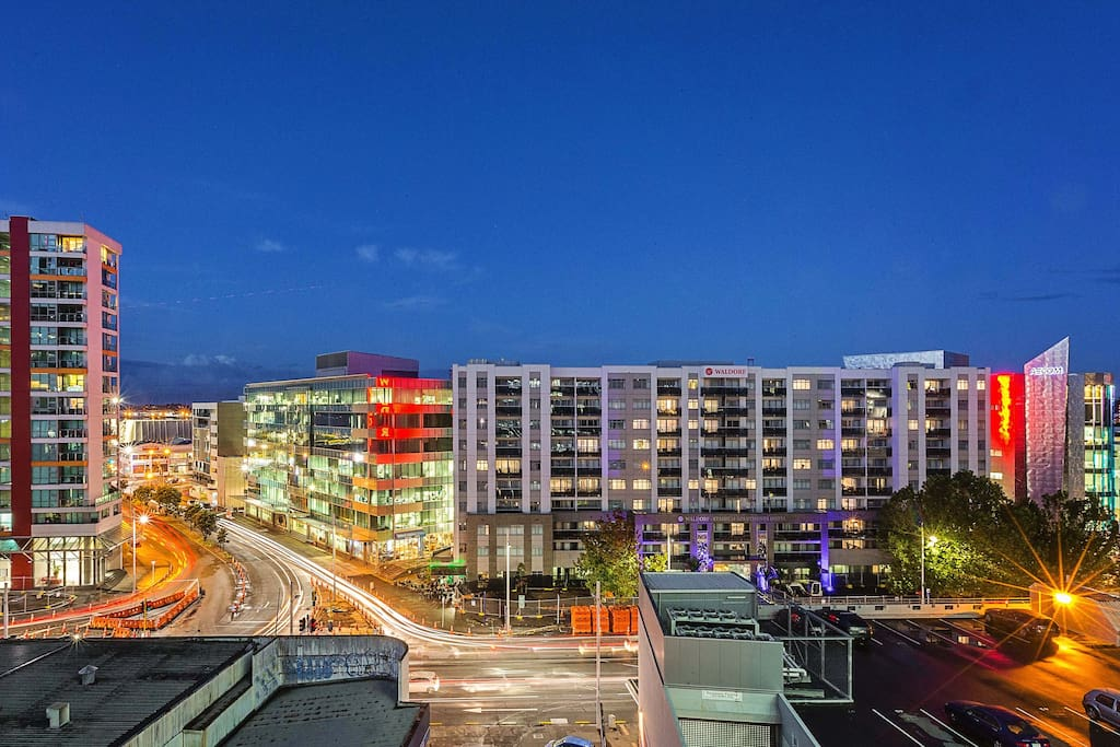 Watch the city lights and action from a private balcony the width of the building