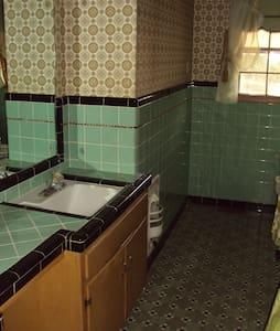 Mid century home invites you - House