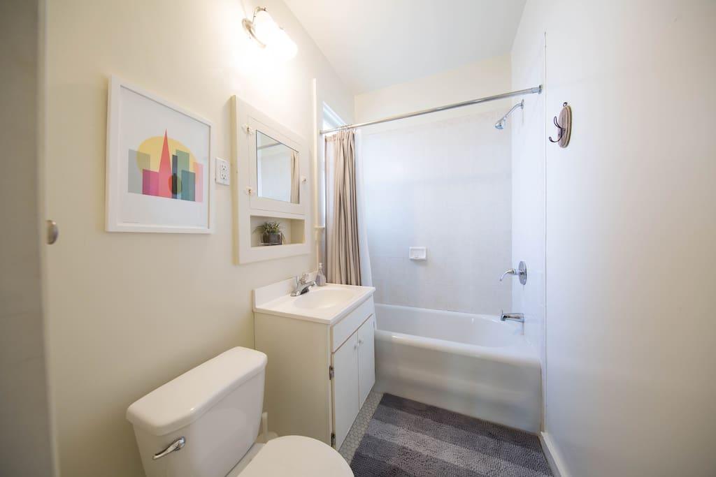 Spacious bathroom with window.