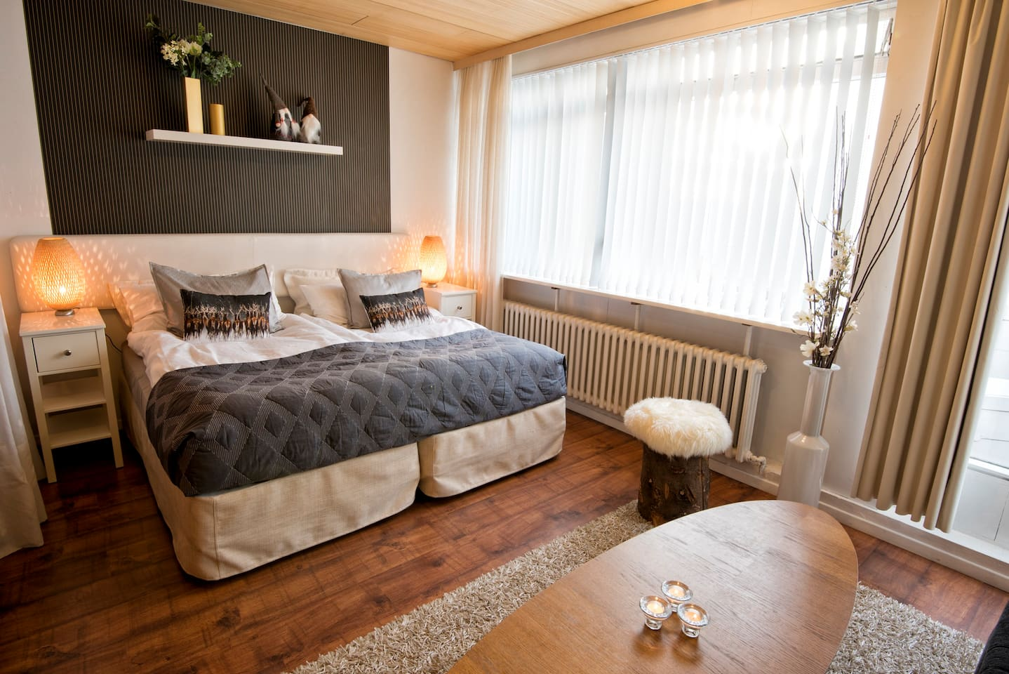 Bedroom with double bed and a sofa bed. The apartment has been through an overall remodeling and makeover