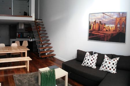 I am subletting my room for the Spring semester while I'm abroad. The apt is a beautiful double height space of 2 floors. In the upstairs lives my roommate and downstairs is my room with a queen size bed all fully furnished.