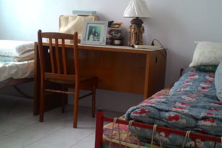 Single room between green lush available - Rumah