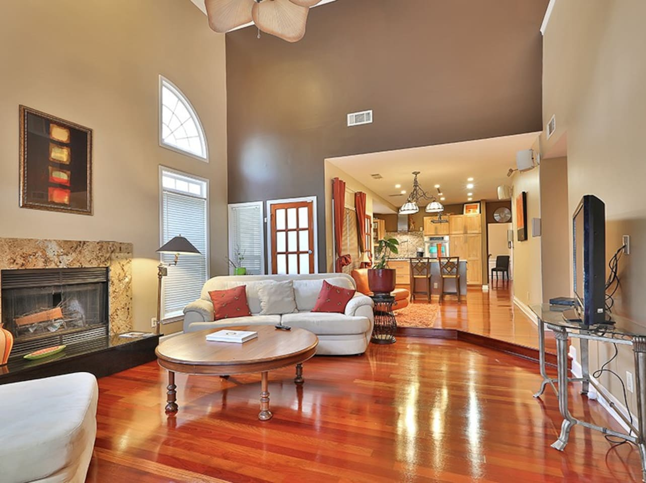 open concept family room and kitchen wood fireplace.