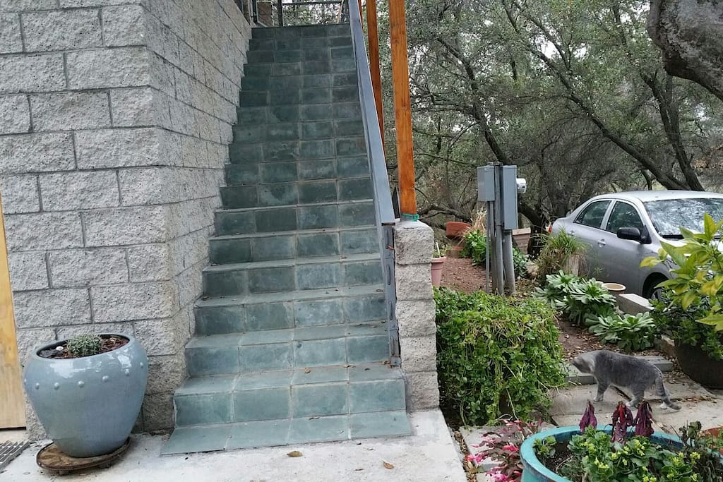 Parking is adjacent to stairs up to the guesthouse