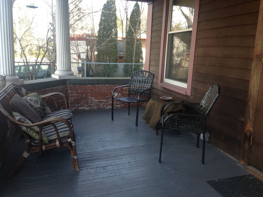 The beautiful stone front porch - enjoy your morning coffee and evening cocktails here!