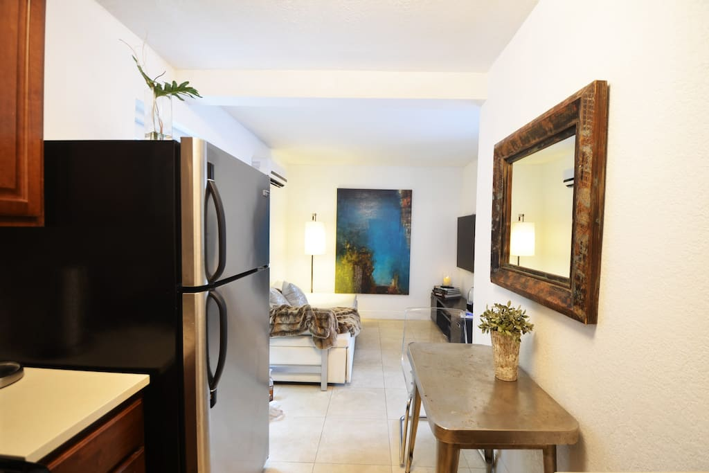 Fully equipped kitchen with cooktop, oven, Nespresso and regular coffee machines, toaster, blender, cutting knives, cutting boards, pots and pans and cooking utensils as well as dinnerware for 4 people.