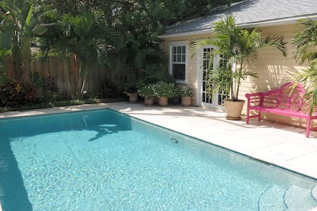 This newly listed historic cottage has 2 bedrooms 1 bath in main house with a newly constructed 1 bedroom 1 bath guest house next to the heated pool.   Newly remodeled with granite counter tops in kitchen, stainless steel appliances, updated baths.