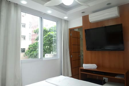 "A small modern economy studio with one double bed. Fully refitted in 2010. Has a Fridge and Microwave, not a full kitchen. 42"" LCD TV with cable TV,  Hi Speed WiFi. 10Mbs.  The apartment is situated near the center of Copacabana."