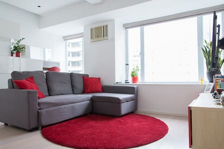 Enjoy our modern, spacious, quiet & sunny 1-bedroom apartment while we're traveling. Super convenient, close to new Sai Ying Pun MTR, Centre St escalator & all the great restaurants on High St. Only a 10-15 minute walk (or easy bus ride) to Central.