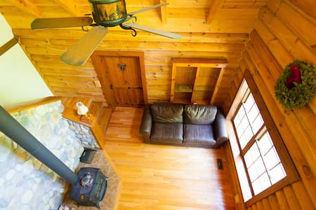 Nestled next to a babbling brook in a private setting just minutes from skiing, dining and shopping this cabin is the north country getaway you've been dreaming about. Stoke the fire and enjoy the hardwood floors, full stainless steel kitchen and open concept vaulted log interior.