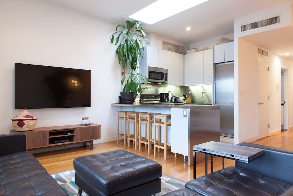 The apartment has wonderful natural light with skylights in every room and both east and west facing views -- the sun rises in the kitchen and sets in the bedrooms.