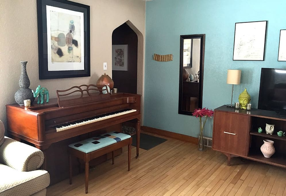Unique architecture with piano and  TV/DVD/wii.