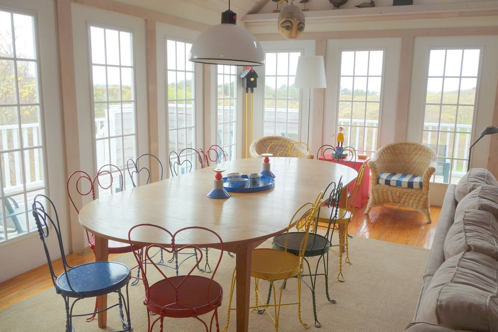 Dining area with deck in background and view to conservation land and harbor
