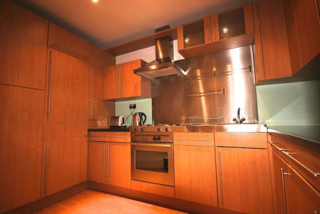 Large modern kitchen with dish washer.