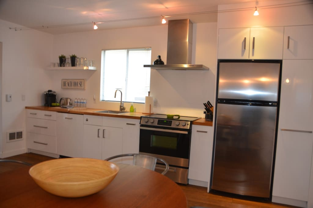 Kitchen with stove, dishwasher, refrigerator, microwave
