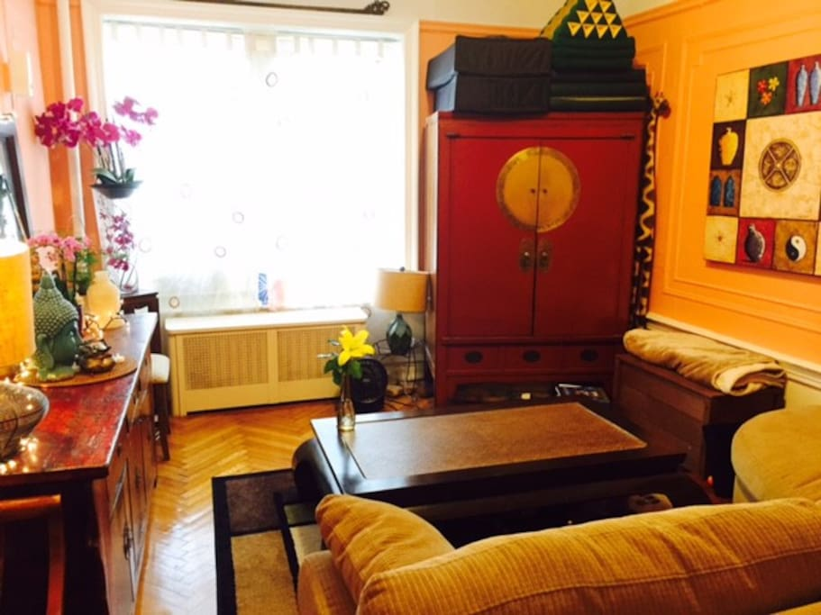 Asian-inspired decor. TV is hidden in the Chinese cabinet.