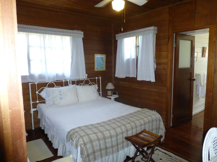 Interior of room with queen size bed.