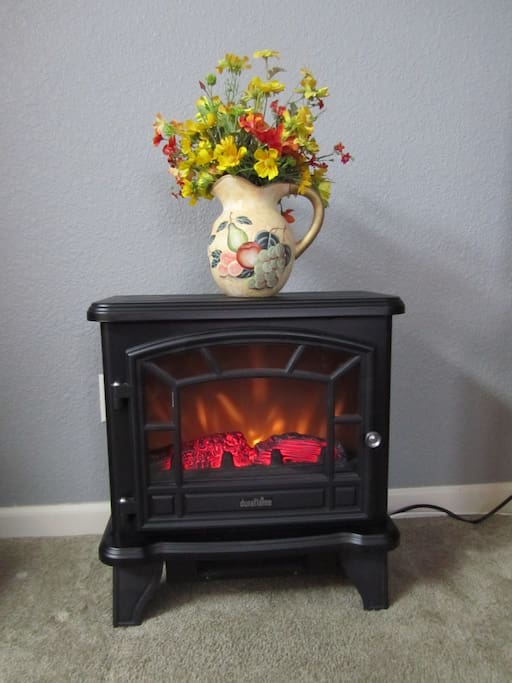 This little electric fireplace adds ambiance and warmth to the chilly winter nights.
