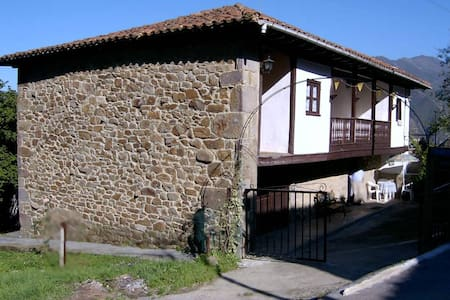 Típica casona asturiana de piedra - House