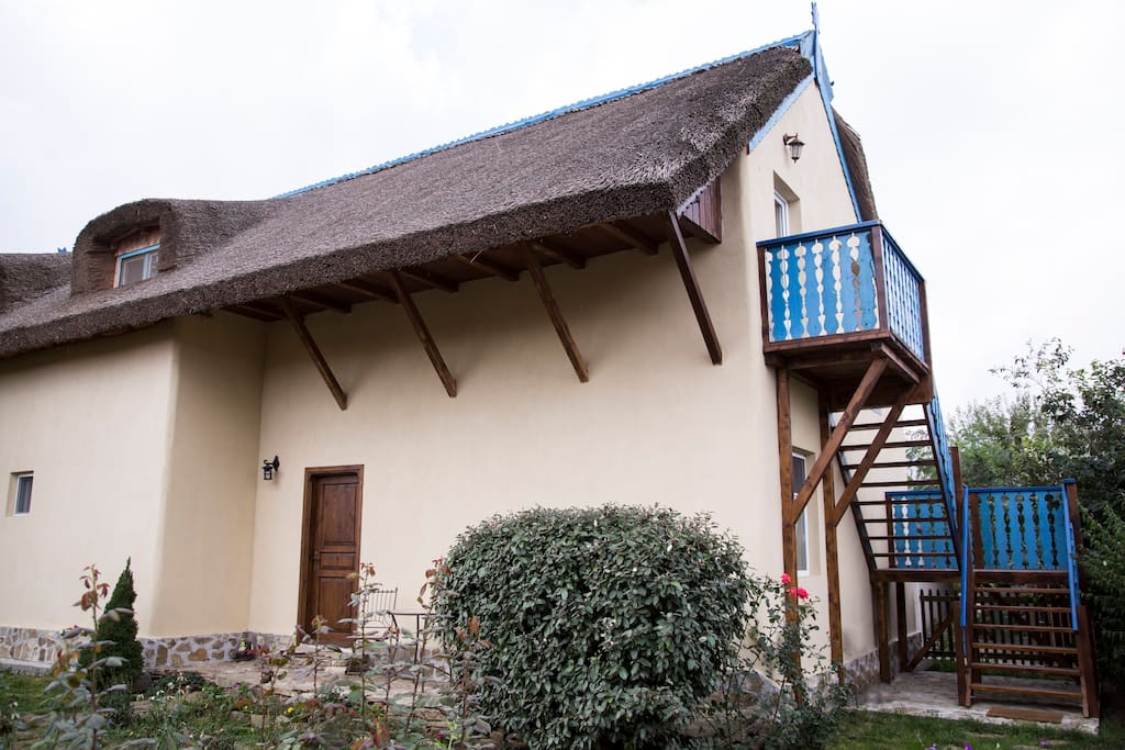 the house is built on the old clay house and it has thatched roof