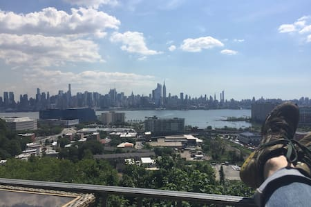 Balcony & Unobstructed Views of Manhattan Skyline - Apartment