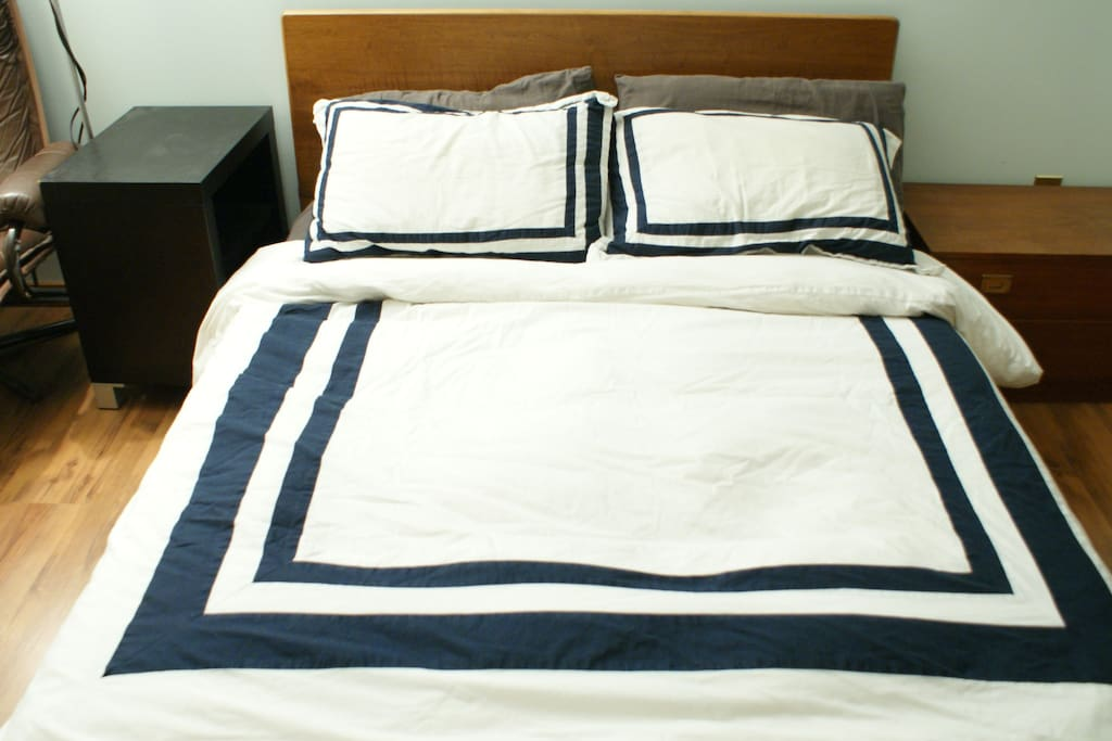 Master bedroom with double size mattress.