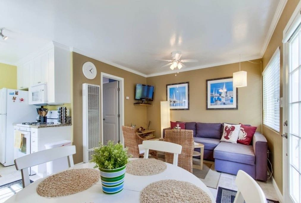 Living room with queen-size sofabed, TV with Cable channels and DVD player, Dining Room seats 4. Portable AC included.