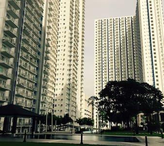 Cozy 1BR condo - Quezon City - Condomínio