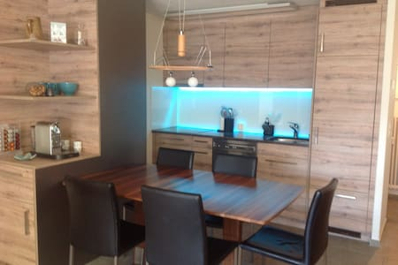 Holiday apartment with dream view in Andermatt - Apartemen