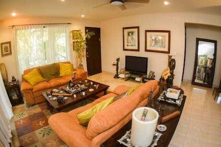 Lovely, ample house surrounded by lush tropical vegetation located just 5 minutes by car from Playa Jaco and 3 minutes from Playa Herradura/Los Suenos Resort & Marina. Shopping center with restaurants and grocery store are just a couple minutes away.