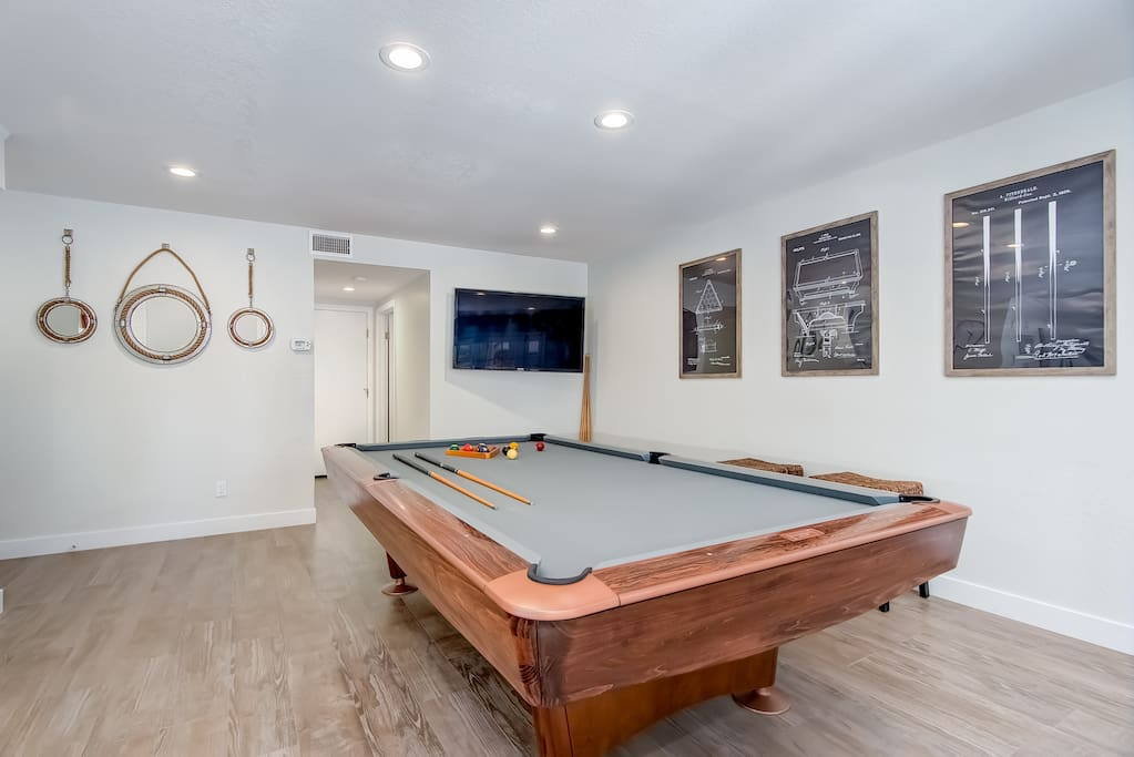 The pool table room features a vintage Brunswick Gold Crown 9ft table!