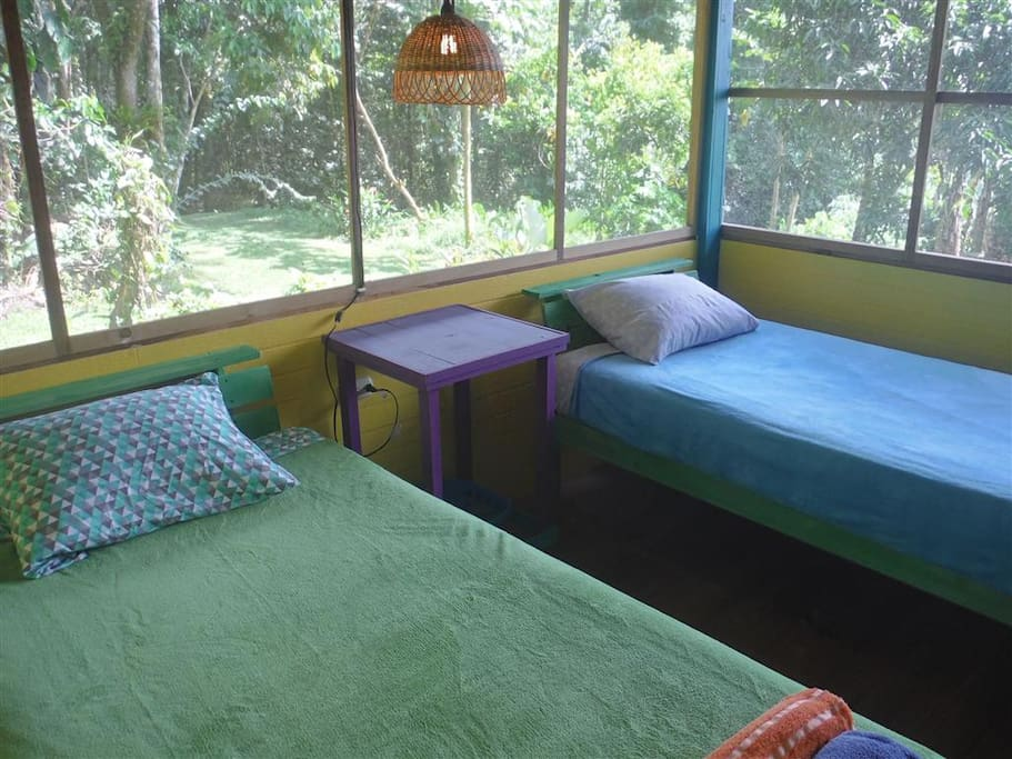 Two twin beds in the screened in bedroom.
