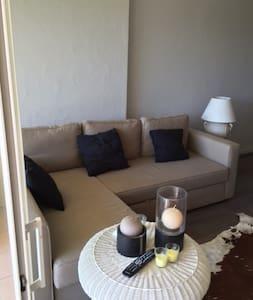 Appartement T2 (40 m2) en rez de jardin vue mer - Lägenhet