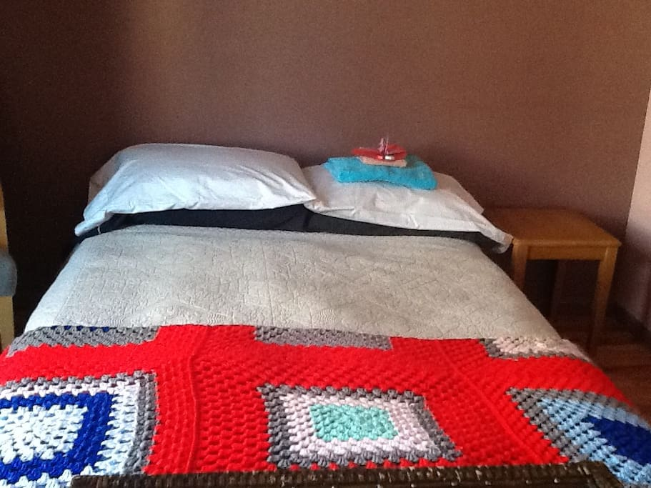 An extra blanket to stay extra warm, with an origami crane on the pillow to greet our guests.