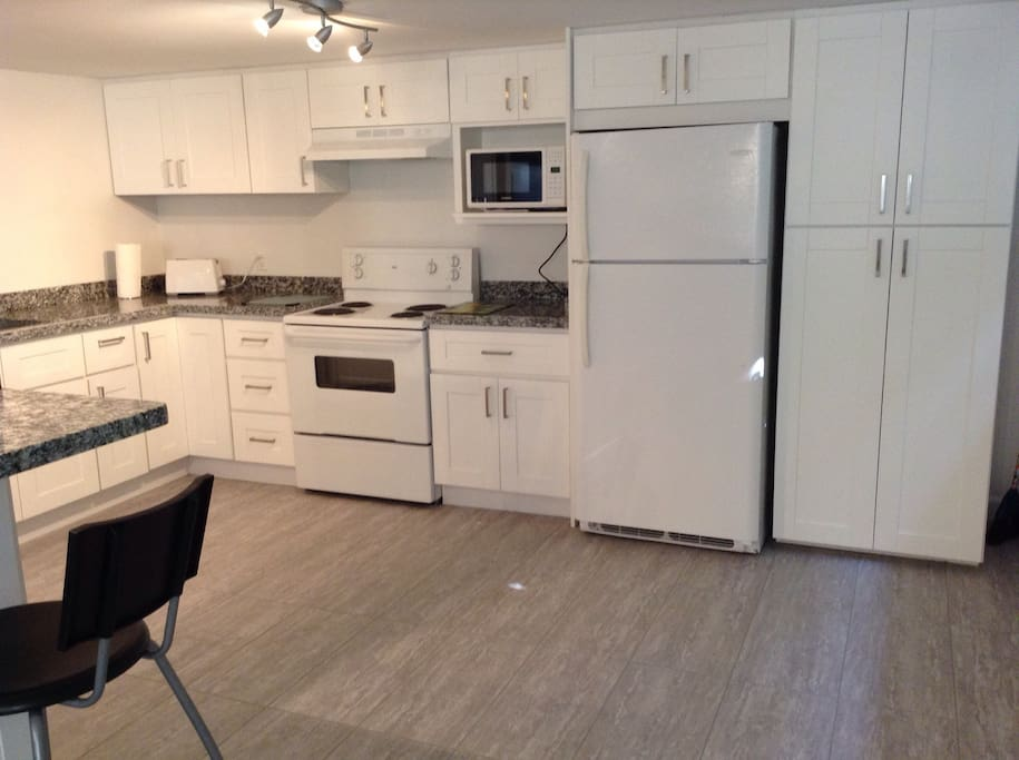 Prepare your meals in this fully equipped brand new kitchen with granite countertops.