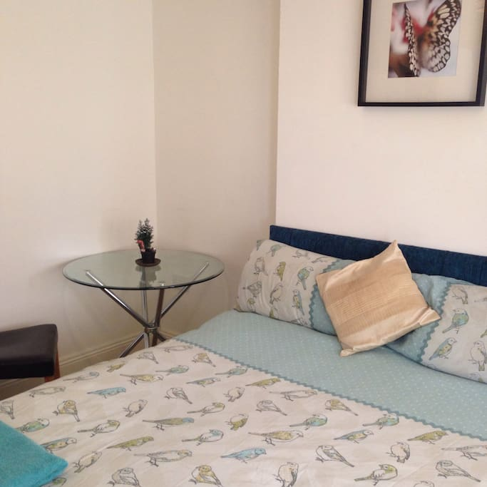 Large cozy bed in a lovely modern clean quiet bedroom on the seafront